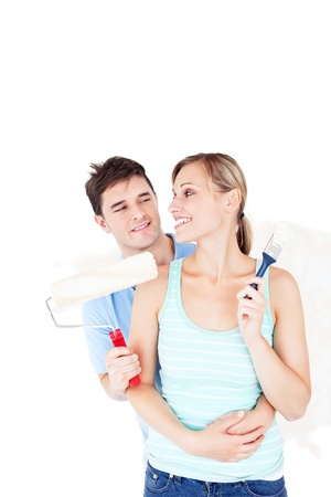 Loving young couple painting a room Stock Photo - 10241271