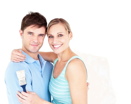 paintrush: Happy young couple painting a room