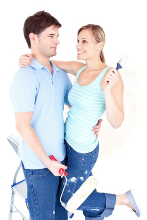 Affectionate young couple painting a room Stock Photo - 10243259