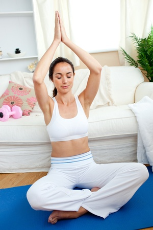 yoga pillows: Bright woman practicing yoga in her living-room Stock Photo