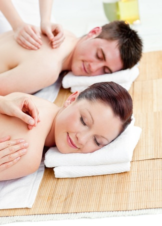 eye massage: Relaxed caucasian couple receiving a back massage Stock Photo
