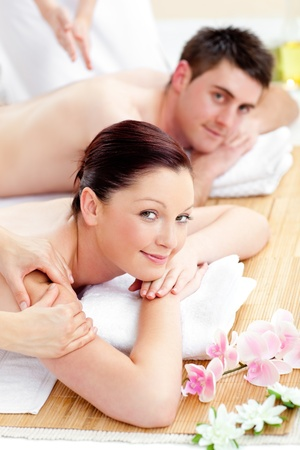 Happy caucasian couple receiving a back massage photo