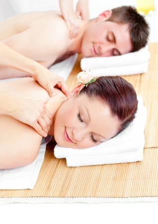 delighted: Delighted caucasian couple receiving a back massage Stock Photo