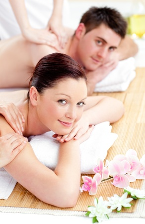 Merry young couple enjoying a back massage photo