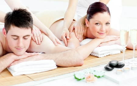 Attractive young couple enjoying a back massage photo