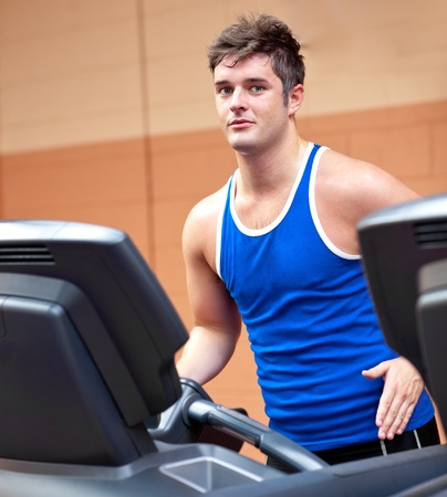 musculation: Good-looking man exercising on a running machine Stock Photo