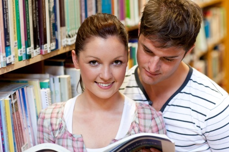 Young caucasian couple reading a book photo