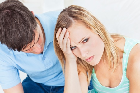 upset woman: Handsome man apologizing after an argument with his girlfriend Stock Photo