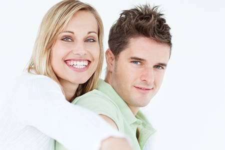Portrait of a cute woman hugging her boyfriend smiling at the camera Stock Photo - 10244217