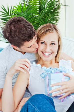 Pleased woman receive a present from her boyfriend  Stock Photo - 10244496