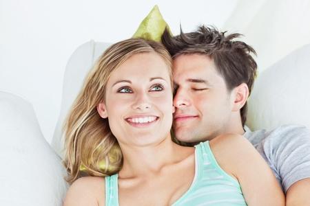 yog: Loving yog couple lying on a sofa Stock Photo