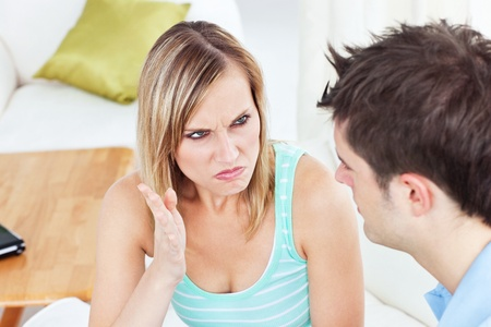 Young couple arguing in ther living-room  photo