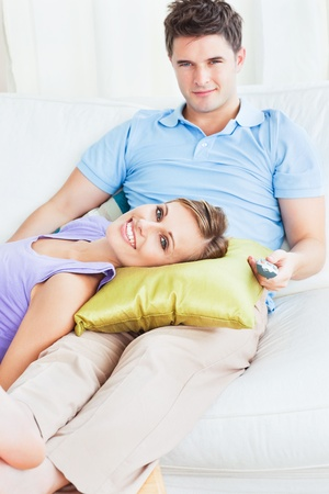 Young couple. woman lying on the mans leg Stock Photo - 10244172