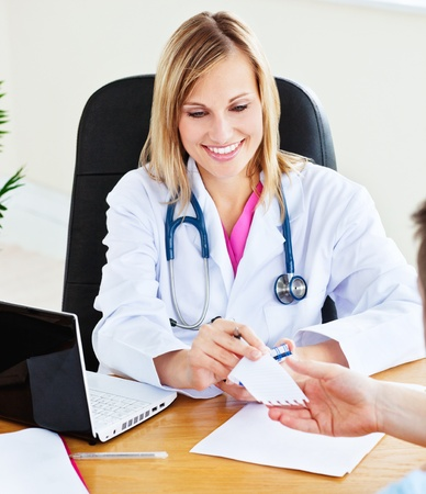 Woman doctor giving notice to her male patient Stock Photo - 10244116