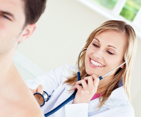 reviews: Smiling doctor is examinating her patient