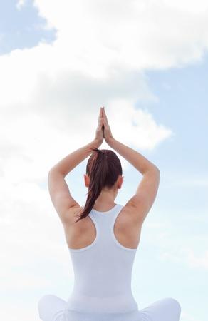 Caucasian woman practising yoga  photo
