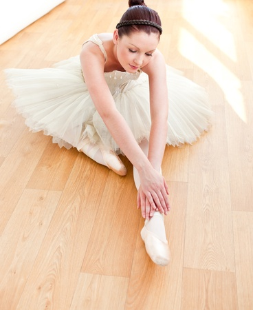 ballerina costume: Beautiful dancer stretching on the floor