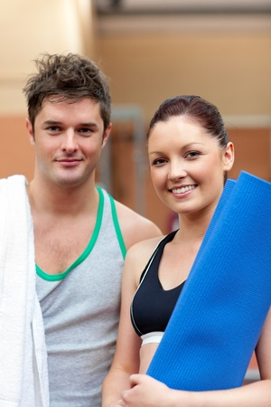 musculation: Portrait of a happy couple after fitness exercises smiling to the camera