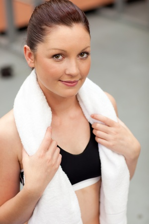 musculation: Portrait of a smart athletic woman with towel around the neck