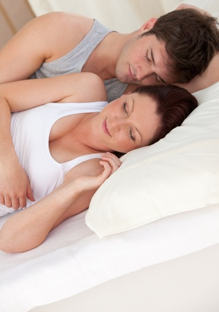 Adorable young future parents sleeping on the bed during the morning Stock Photo - 10244052