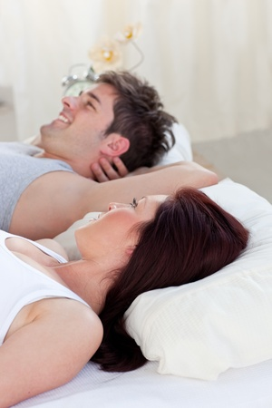 Portrait of a happy man lying on the bed with his pregnant woman Stock Photo - 10243860
