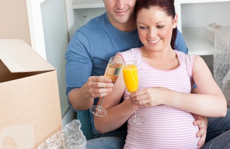 Close-up of an adorable couple celebrating pregnancy and removal with champagne photo