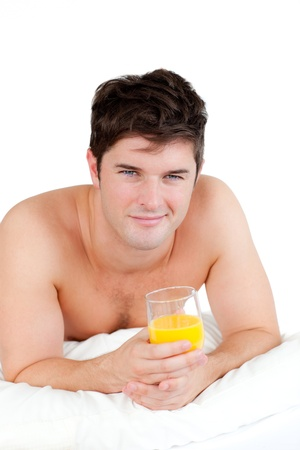 barechested: Bare-chested man lying on his bed with a glass of orange juice