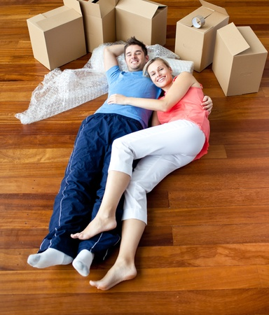 first time buyer: Young couple lying on floor