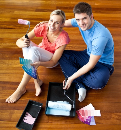 first time buyer: Young couple sitting on the floor smiling Stock Photo