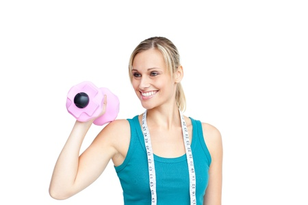 musculation: Smiling young woman holding dumbbells Stock Photo