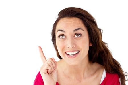 Cheerful hispanic woman pointing upward photo