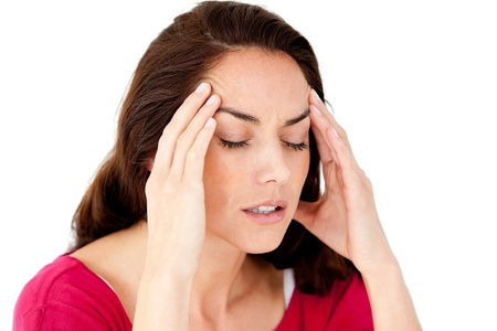 Beautiful hispanic woman having a headache photo