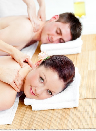 Attractive young couple receiving a back massage photo