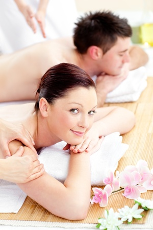 Merry young couple receiving a back massage photo