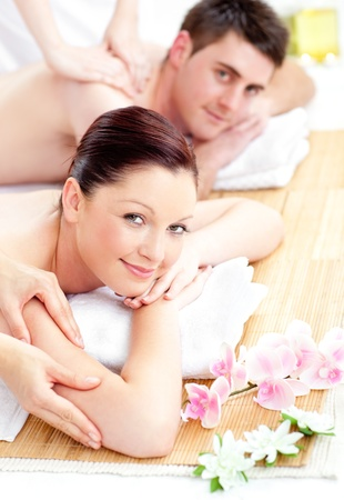 delighted: Delighted young couple receiving a back massage Stock Photo