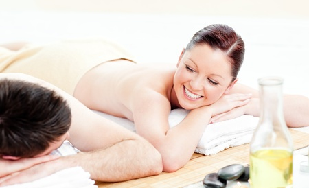 Caucasian young couple receiving a back massage photo