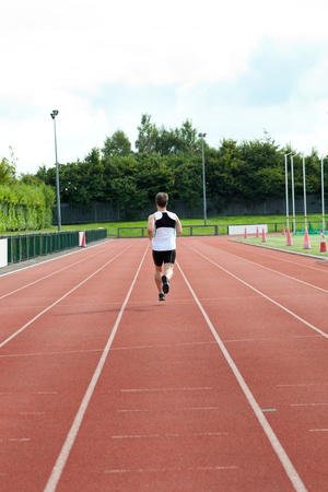 Concentrated male sprinter training photo