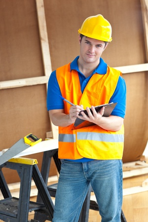 Confident male worker holding a clipboard photo