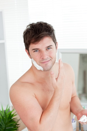 shave: Cute caucasian man ready to shave in the bathroom
