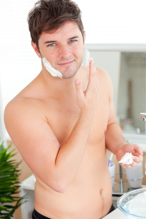 midlife: Attractive caucasian man ready to shave in the bathroom Stock Photo