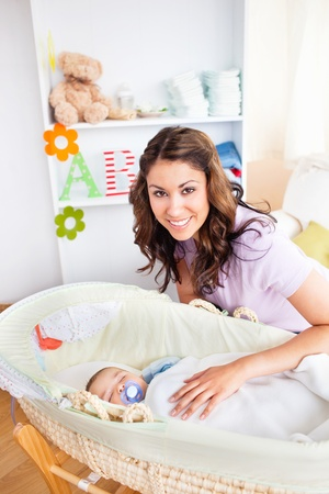 lookalike: Attentive young mother taking care of her adorable baby