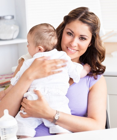 lookalike: Caucasian young mother taking care of her adorable baby