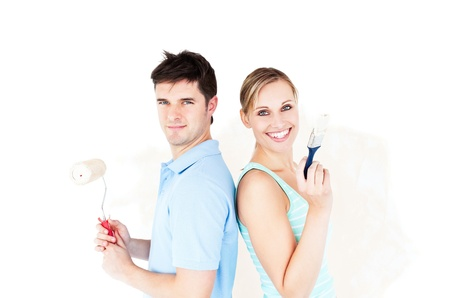 Charismatic couple painting a room Stock Photo - 10243515