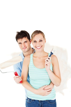 paintrush: Cheerful couple painting a room Stock Photo