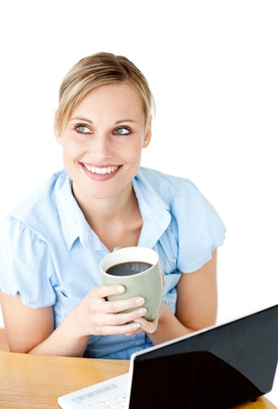 Glowing businesswoman drinking coffee smiling at the camera photo