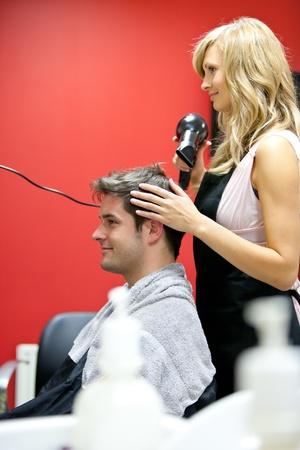 Blond hairdresser drying her customer Stock Photo - 10244338