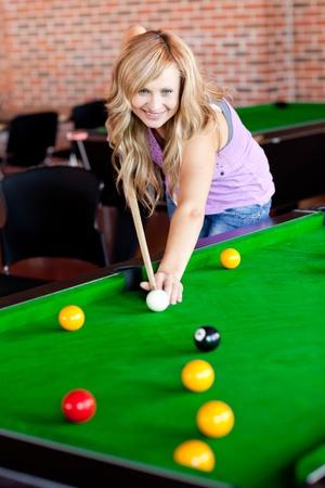 Bright woman playing pool photo