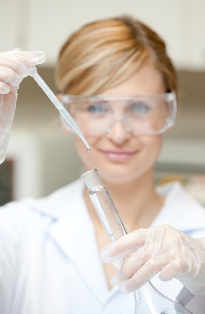 Portrait of a charming female scientist using a pipette Stock Photo - 10244982