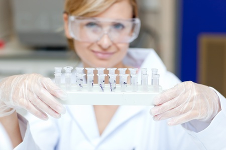 Portrait of a smiling female scientist holding different samples Stock Photo - 10244988