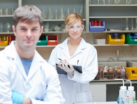Two assertive scientists looking at the camera standing Stock Photo - 10244980